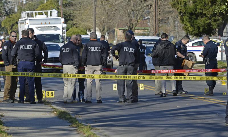Officers investigate the scene of a shooting in Baton Rouge, La., in February.