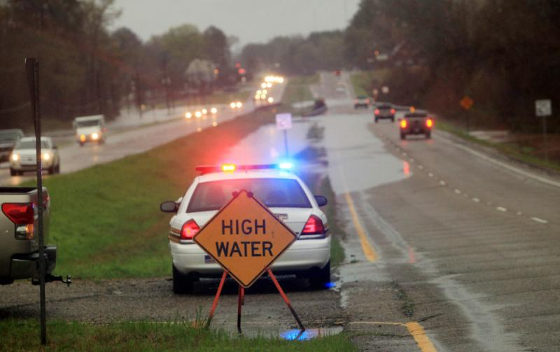 Police monitor floodwaters in Haughton, La., in March. The state has expanded its hate-crime laws to also protect law enforcement and first responders.
