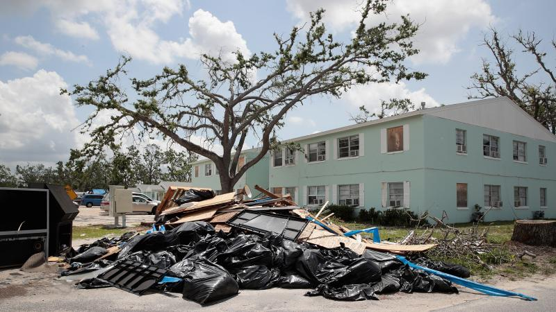 Debris is piled on May 10 outside an apartment complex that was damaged by Hurricane Michael in Panama City, Fla. Rep. Chip Roy objected to a procedural vote on a bipartisan $19.1 billion disaster aid bill, forcing Congress to wait until June to finish wo