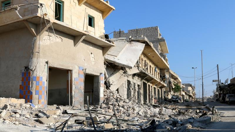 Buildings and debris in Aleppo's Darat Izza district, in Syria, on Sunday.