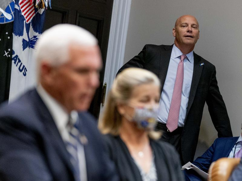 Marc Short, the chief of staff to Vice President Pence, listens to Pence speak during a White House event in September. Short is the latest White House aide to test positive for the coronavirus.