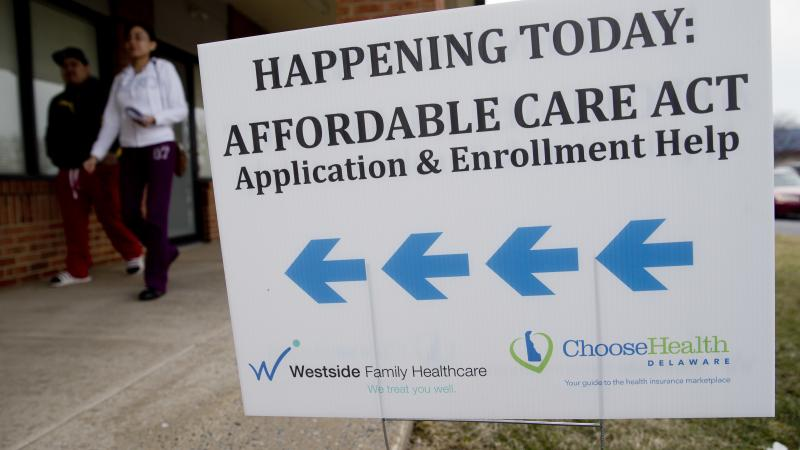 Enrollment help was plentiful for insurance sign-ups in the early years of the Affordable Care Act, such as at this clinic in Bear, Del., in 2014. Though the Trump administration has since slashed the outreach budget, about 930,000 people have signed up f