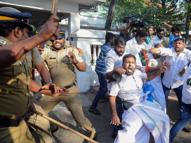 Indian police take protesters into custody during widespread demonstrations over two women entering the Sabarimala temple in the southern India state of Kerala earlier this week.