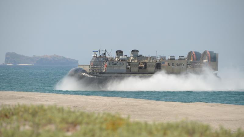 A U.S. Navy hovercraft prepares to hit the beach during amphibious-landing exercises as part of an annual joint U.S.-Philippine military exercise on the shores of San Antonio, facing the South China Sea, in Zambales province, Philippines, on April 11, 201