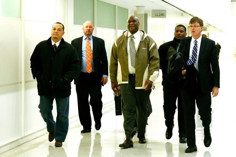 Three Rikers corrections officers — Alfred Rivera (left), Tobias Parker (center) and Jeffrey Richard (second from right) — arrive at court in March. Rivera and Parker were among the five officers convicted, while Richard was found not guilty.