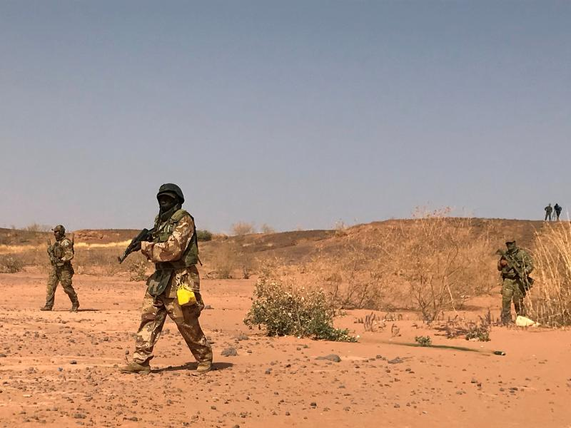 Nigerien commandos simulate a raid on a militant camp during U.S.-sponsored exercises in Ouallam, Niger, in April 2018. A spokesman for the Nigerien army says 71 soldiers were killed in an attack on Tuesday.