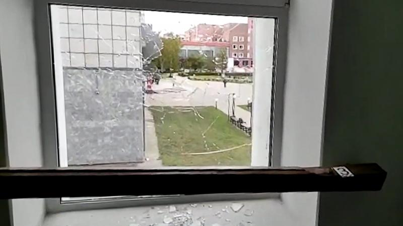 A broken window is pictured at the Perm State University where an unidentified man opened fire, killing at least eight people and injuring 24 others.