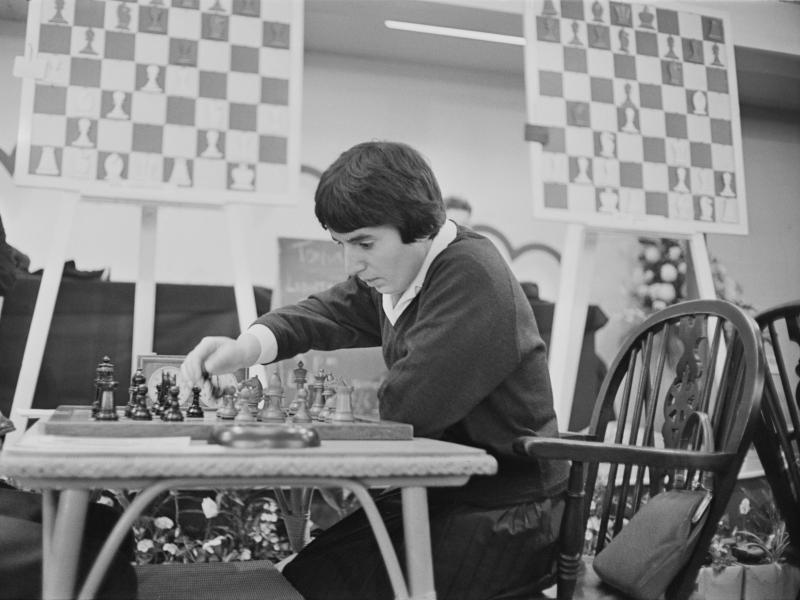 Georgian chess champion Nona Gaprindashvili plays at the International Chess Congress in London on Dec. 30, 1964. She is suing Netflix for defamation and invasion of privacy over its series The Queen's Gambit.