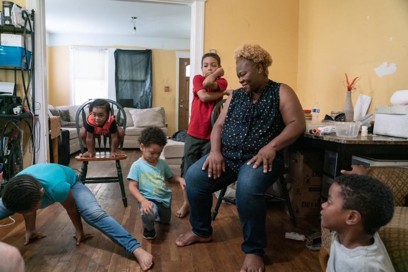 """Bridget Desmukes (center) and her husband, Jeffrey, love having a big, active family. """"The kids are always climbing on things, flipping all the time — it's not dull,"""" she says, laughing. Because Desmukes had developed preeclampsia in a previous pregnanc"""