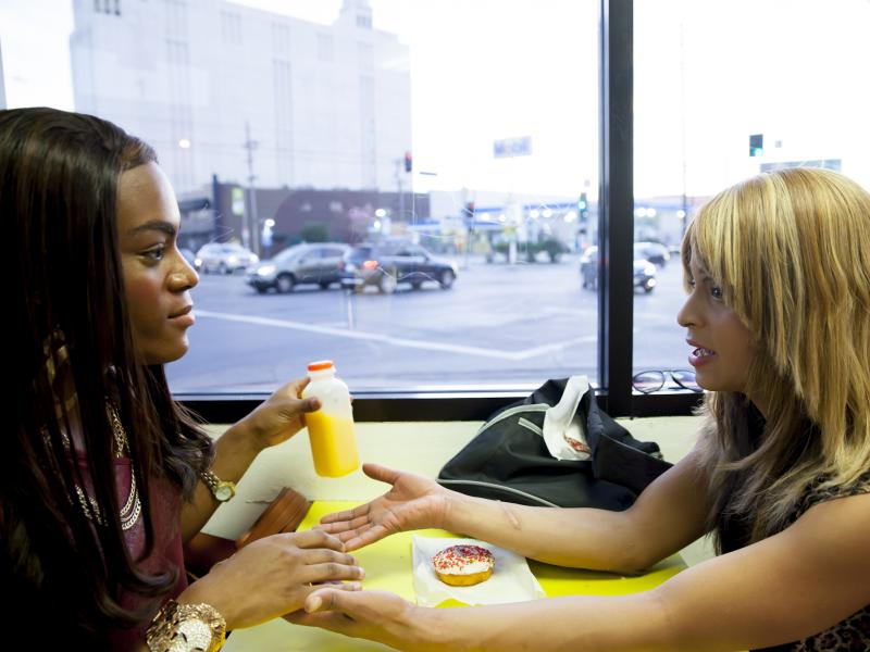 Alexandra (Taylor) and Sin-Dee (Kitana Kiki Rodriguez) take a break on Christmas Eve in Tangerine.