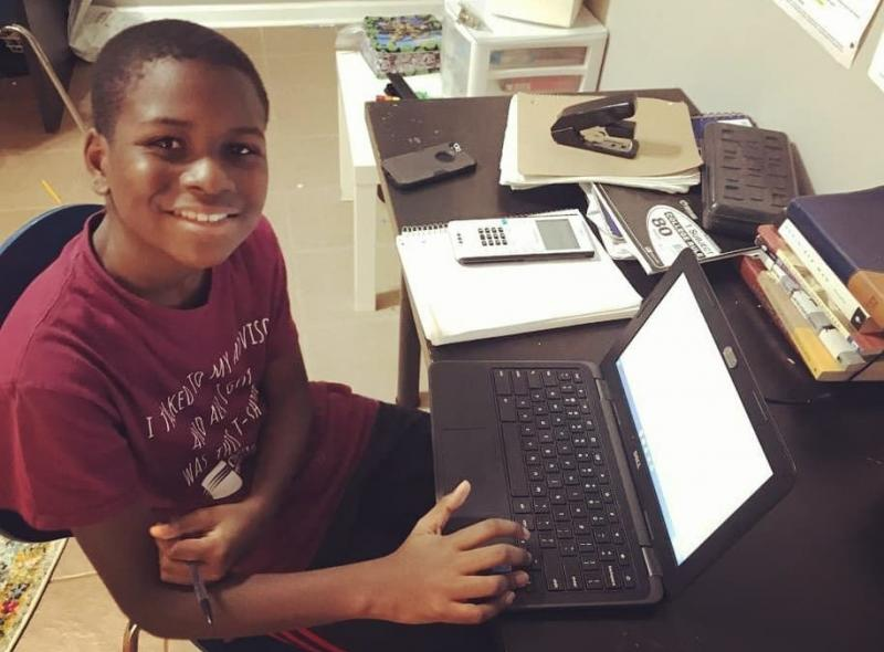 Caleb Anderson, 12, attends virtual calculus class this month at Chattahoochee Technical College in Marietta, Ga., where he is a sophomore.