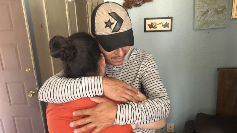 Jose Eduardo hugs his 15-year-old daughter Yaimy, 10 months after they were separated at the U.S. border.