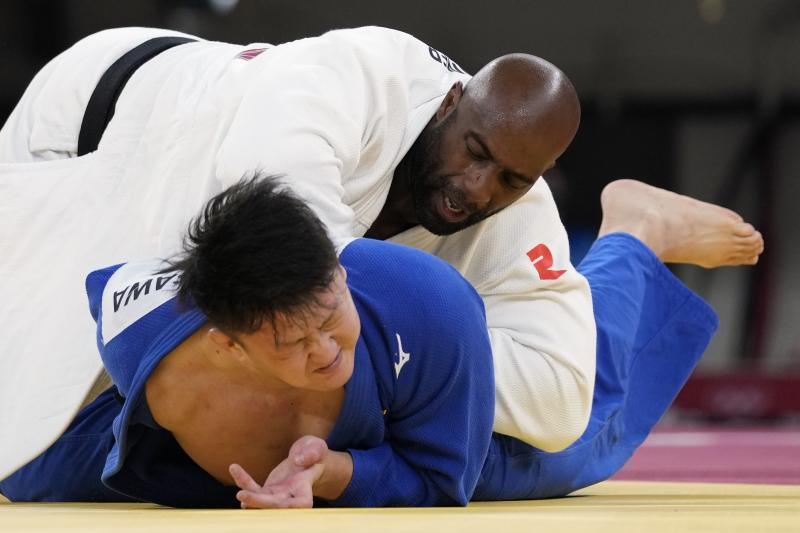 Riner (top) and Japan's Hisayoshi Harasawa compete Friday during the men's over 100-kilogram bronze medal judo match.