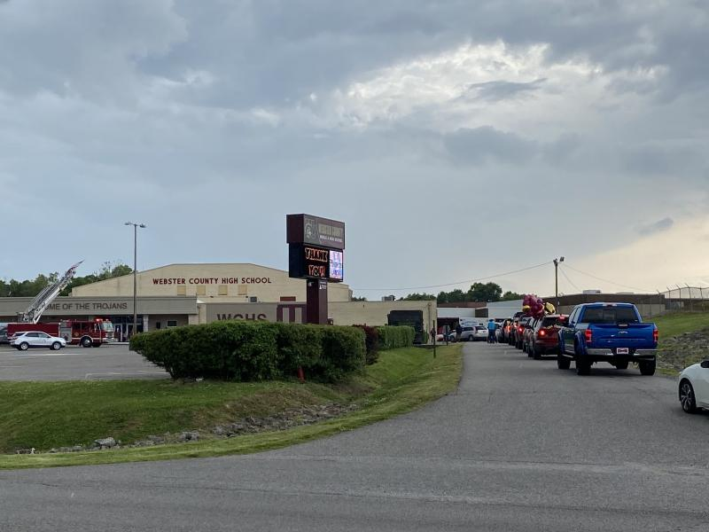 Seniors line up in cars with their families in the main drive of Webster County High School in Dixon, Ky., waiting to pick up their diplomas outside of the school one at a time. Like almost all schools across the U.S., county high school officials had to