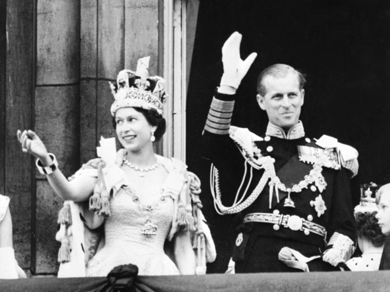Queen Elizabeth II and Prince Philip wave to the crowd after her coronation at Westminster Abbey in London on June 2, 1953.