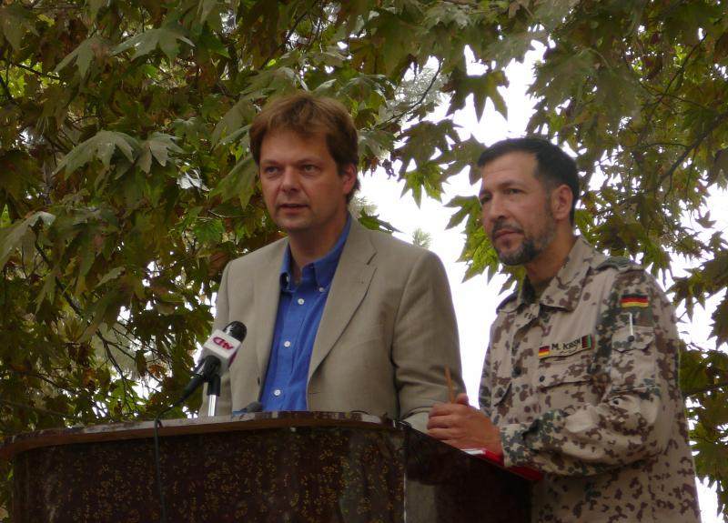 German official Philipp Ackermann gives a speech with military translator Mohamed Oda in 2006, while heading the Provincial Reconstruction Team.