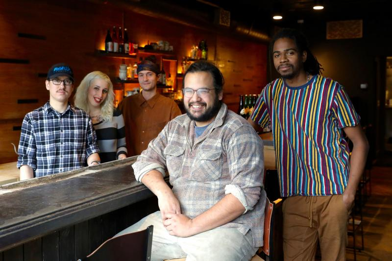 James Mark (center) inside his restaurant Big King, along with cooks (from left) Oscar Lange, Emily Joslyn, Peter Kachmarsky and JC Kuvaszko. Mark employs fewer than 50 people so isn't required to provide health benefits. But it helps with staff retention