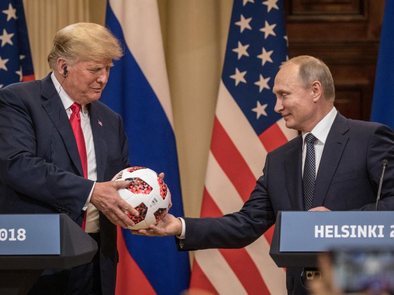 Russian President Vladimir Putin hands President Trump a World Cup soccer ball during a joint news conference after their July 2018 summit in Helsinki.