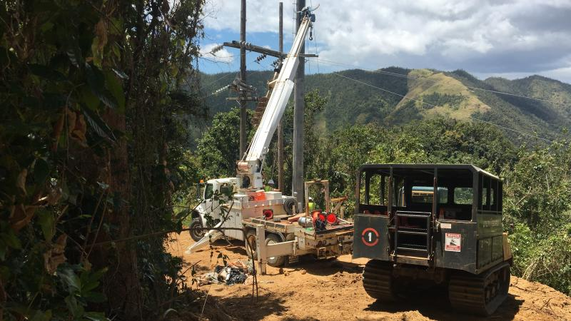 Contractors working to restore power in Cayey, Puerto Rico, last week, the same region where a falling tree interrupted a main transmission line Thursday, plunging 840,000 customers into darkness.