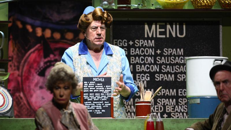 """Terry Jones performs the famous """"Spam"""" sketch during 2014's Monty Python Live (Mostly) stage show. Jones died at the age of 77 after suffering from dementia."""