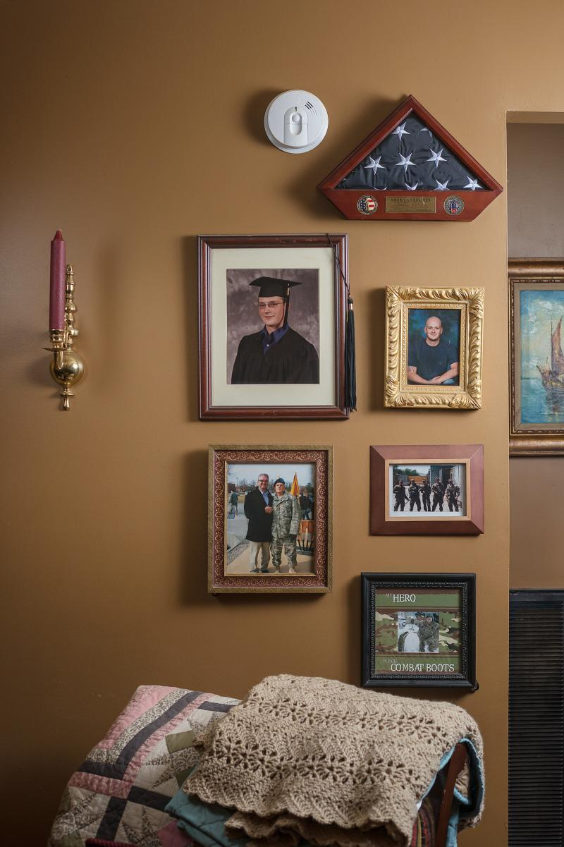 Photos of Sgt. Toombs are displayed at his father's home. John was abruptly kicked out of the Murfreesboro VA residential drug program for being late to take his medication in 2016.