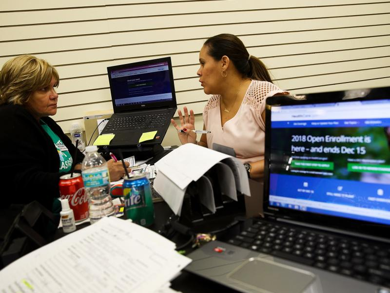 Margarita Mills (left), an insurance agent from Sunshine Life and Health Advisors, helped Daniela Morales shop for an Affordable Care Act health plan at the Mall of the Americas in Miami last month.
