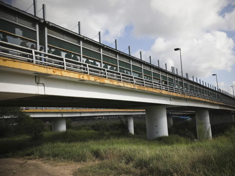 Pedestrians on the Puerta Mexico bridge, which crosses the Rio Grande, wait to enter Brownsville, Texas, at a legal port of entry in Matamoros, Mexico, in August.