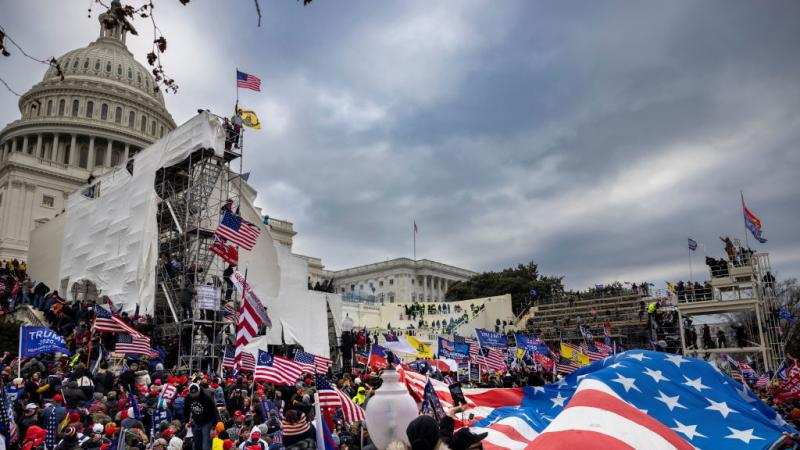 Trump supporters clash with police and security forces as people try to storm the U.S. Capitol on Jan. 6.