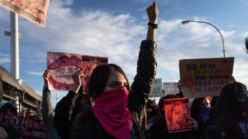 Protesters gather on the Paso del Norte International Bridge in Ciudad Juarez, Mexico on Saturday to demand justice for artist and activist Isabel Cabanillas, 26, who was killed in the streets of Juarez, Mexico.