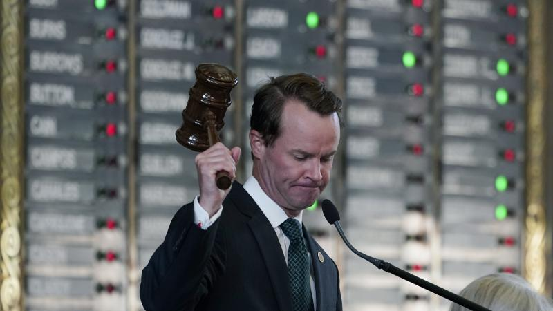 Texas Republican House Speaker Dade Phelan strikes his gavel as the House votes on an amendment to election bill SB1 on Thursday. The legislation easily passed in the GOP-led chamber.