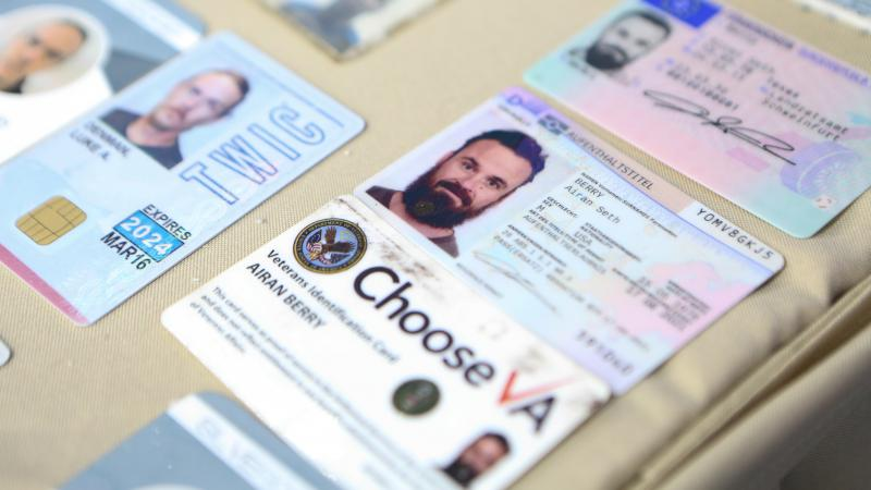 This photograph released by the Venezuelan government purports to show the ID cards confiscated from Airan Berry and Luke Denman in Caracas. The former U.S. service members are now in detention after Venezuelan security forces stifled an ill-fated raid ea
