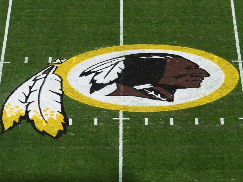 The Washington Redskins' logo is seen before a game in 2019 in Landover, Md. The Redskins have announced the team will be dropping its moniker, which is widely considered a slur against Native Americans.