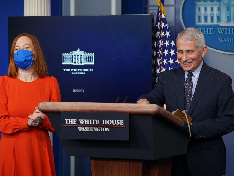 Dr. Anthony Fauci and White House press secretary Jen Psaki face reporters Thursday during the daily White House briefing.