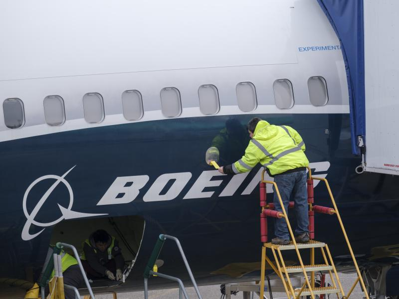 A Boeing employee works on the fuselage of a 737 Max 9 test plane at the company's factory in Renton, Wash., on March 14. Orders for durable goods jumped 2.7% last month, fueled in part by strong demand for commercial aircraft.