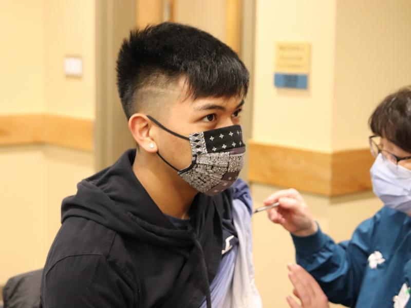 Seventeen-year-old Bradley Westlock receives his second COVID-19 vaccine shot. He and other teens in Sitka, Alaska, are eligible now that higher risk populations have already received the vaccination.