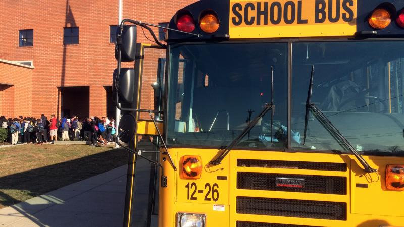 A school bus drop off students in Nashville, Tenn., where the city's school district has experienced one of the worst shortages of drivers in the country.