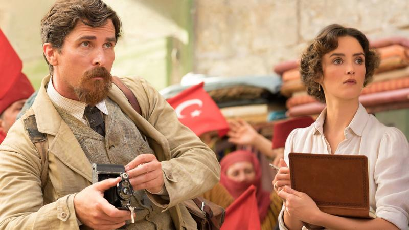 Chris (Christian Bale) and Ana (Charlotte Le Bon) have a reason to look worried in Terry George's The Promise.