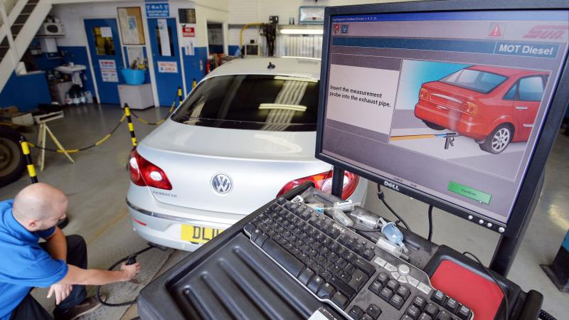 A Volkswagen Passat is tested for exhaust emissions, at a Ministry of Transport testing station in London. In the U.S., a 1998 copyright law prevents safety researchers from accessing the software that runs cars.