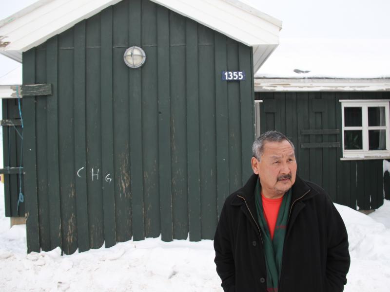 Orto Ignatiussen outside his home in Tasiilaq, Greenland, in 2016.