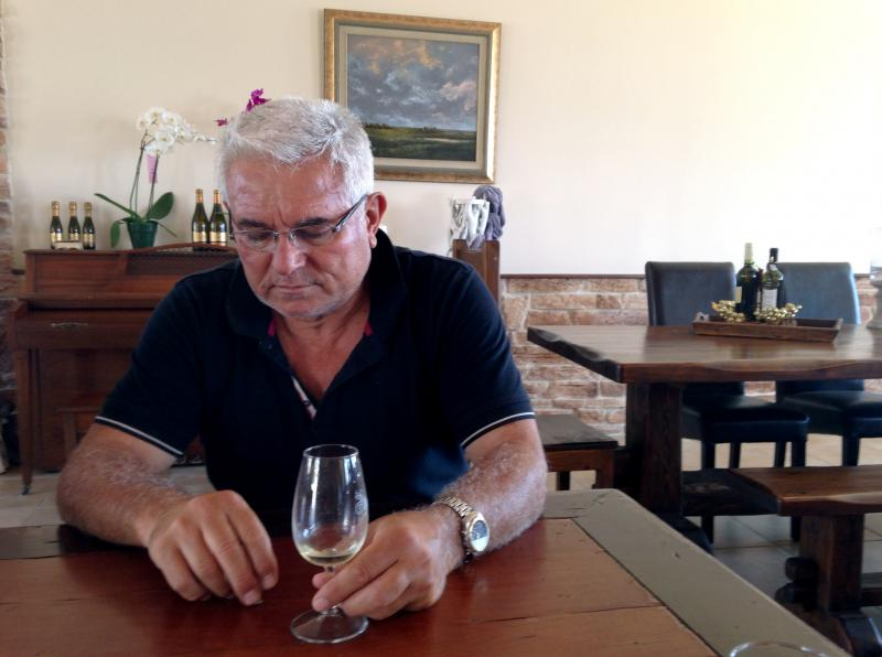 "Petros Hatzigeorgiou, whose family has been making wine for more than 150 years, at his winery outside the village of Atsiki, Lemnos. He says islanders can weather the tax by working harder. ""That's how we can fight it, no matter how much it hurts,"" he sa"