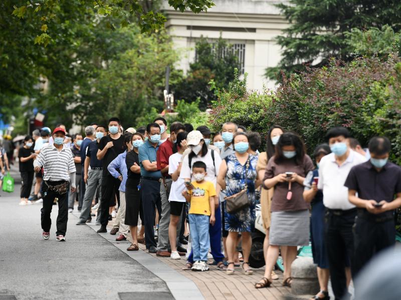 People line up for coronavirus testing on Thursday in Nanjing, in China's Jiangsu province.
