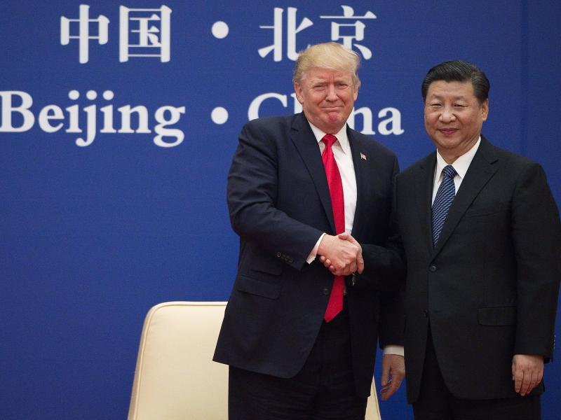 President Trump and Chinese President Xi Jinping shake hands during a business leaders event in Beijing on Nov. 9, 2017. The two leaders are expected to discuss trade at this week's Group of 20 summit in Japan.