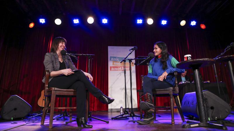 Host Ophira Eisenberg chats with comedian Aparna Nancherla on Ask Me Another at the Bell House in Brooklyn, New York.