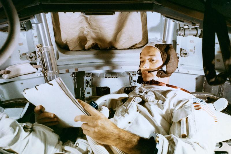 Collins studies the flight plan during simulation training at the Kennedy Space Center before the scheduled Apollo 11 mission.