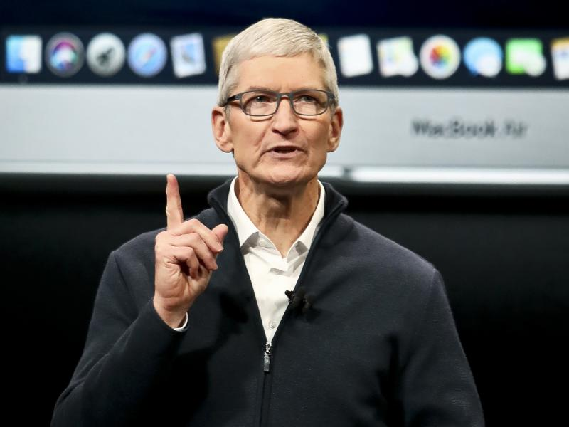 Apple CEO Tim Cook attributed slower sales in China in part to the devaluation of the yuan.