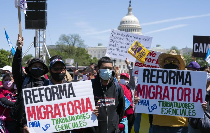 Immigration rights supporters rally Saturday on the National Mall in Washington, D.C., demanding citizenship for essential workers.