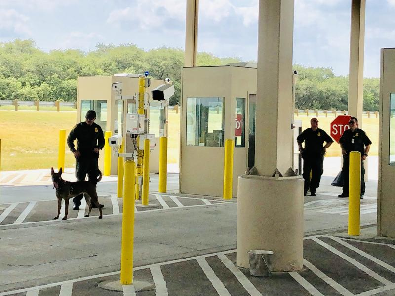 Border Patrol agents with a sniffer dog at the new and expanded Falfurrias checkpoint.