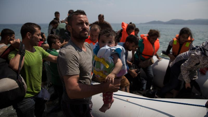 Migrants arrive Monday on the Greek island of Chios, where residents have been assisting the new arrivals.