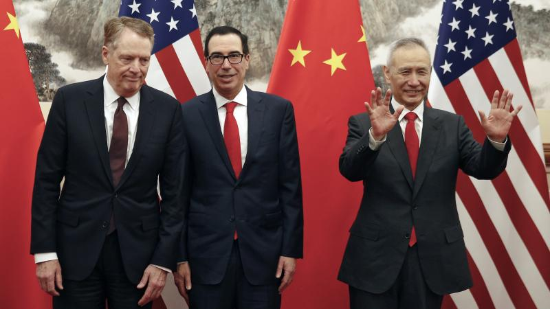 U.S. Trade Representative Robert Lighthizer (from left),  U.S. Treasury Secretary Steven Mnuchin and Chinese Vice Premier Liu He gather for a meeting in Beijing on May 1. They are due to meet again in Shanghai this week.