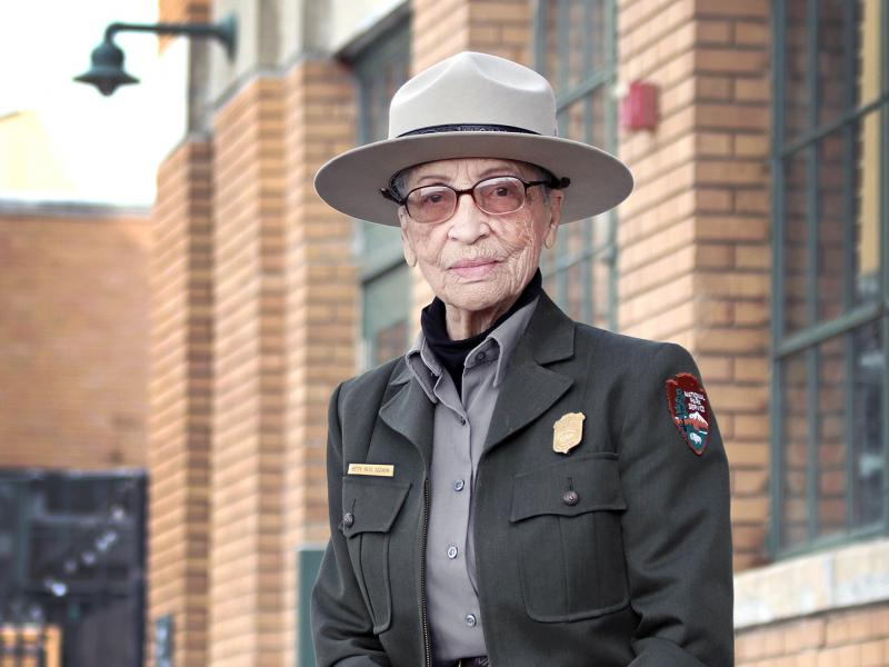 Ranger Betty Reid Soskin sits in front of the Rosie the Riveter/WWII Home Front National Historical Park Visitor Education Center. Soskin is celebrating her 100th birthday, serving as the nation's oldest National Park Service ranger.